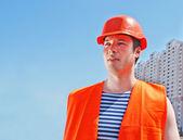 Builder worker in uniform and helmet — 图库照片