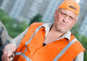 Senior builder at work — Stock Photo