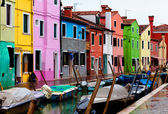 Venice, Burano island canal, small colored houses and the boats — Stock Photo