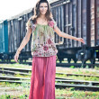 Beautiful woman waiting for the train on railway tracks — Stock Photo
