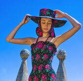 Young woman in stylish hat walking in the park. Ethnic style. — Stock Photo