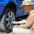Senior man changing a wheel of his car — Stock Photo #11949224