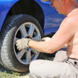 Senior man changing a wheel of his car — Stock Photo #11949233