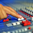 Hand moving the level on proffesional audio mixer. Focus have a little DOF , near hand — Stock Photo