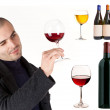 Young man with glass of red wine. Collage of bottles and glasses of wine — Stock Photo