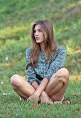 Portrait of young beautiful serious woman outdoors — Stock Photo
