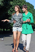 Young couple walking on path in park - Outdoor — Stock Photo