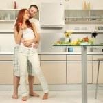 Couple on kitchen — Stock Photo