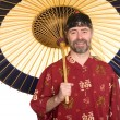 Stock Photo: Min Chinese shirt hold umbrella