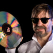 Man with the retro laser disc — Stock Photo