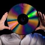 Man holds retro laser disc — Stock Photo #10882958