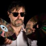 Man holds a retro laser discs — Stock Photo #10882979