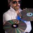 Man holds a retro laser discs — Stock Photo