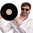 Music lover with an old vinyl disc — Stock Photo #10883069