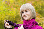 Thoughtful girl holds a scarf — Stock Photo