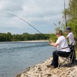 Grandfather and grandson go fishing — Stock Photo #11657258