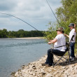 Grandfather and grandson fishing — Stock Photo