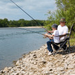Grandfather and grandson fishing — Stock Photo #11657286