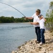 Royalty-Free Stock Photo: Grandfather and grandson fishing