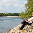 Fisherman in the river — Stock Photo