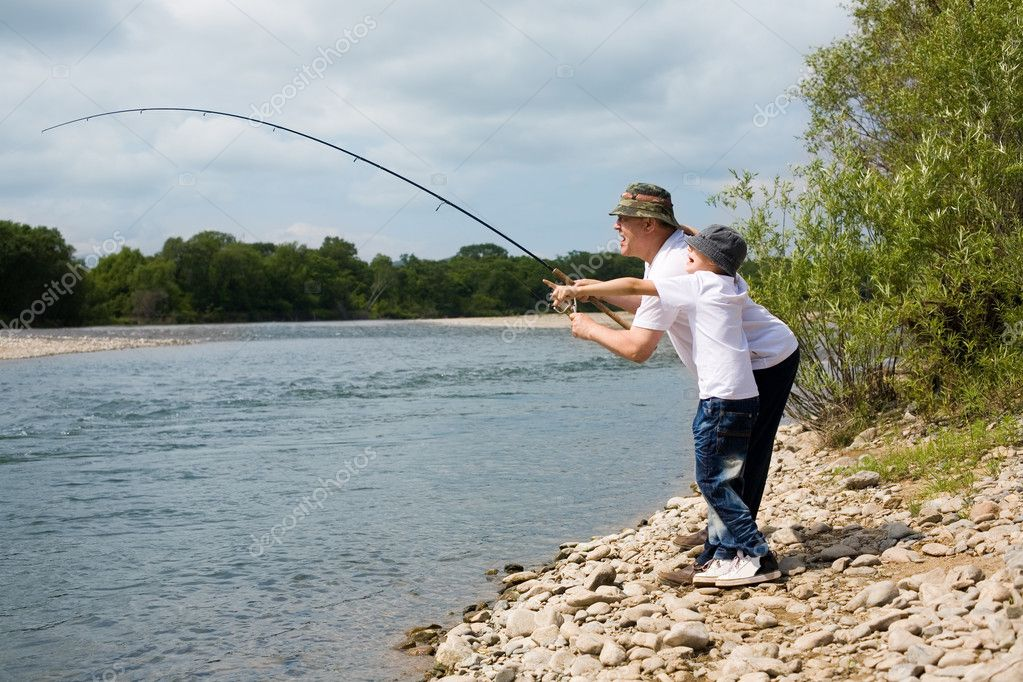 Gambling grandfather and grandson fishing. — Stock Photo #11657306