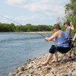 Grandfather and grandson fishing on weekend — Stock Photo #11669639