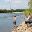 Grandfather and grandson fishing — Stock Photo #11669716