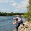 Grandfather and grandson fishing — Stock Photo #11669745