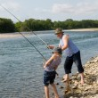 Grandfather and grandson fishing — Stockfoto