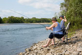 Grandfather and grandson fishing on weekend — Stock Photo