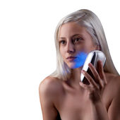Young woman getting phototherapy treatment — Stock Photo