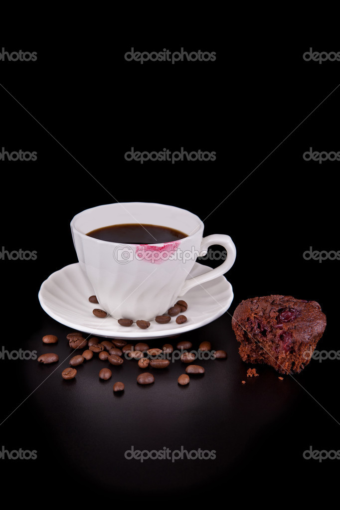 Hot coffee cup with red lipstick and muffin on black  Stock Photo #11736058