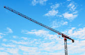 Building crane and blue sky — Stock Photo