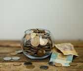 Ukrainian coins and hryvnas shows poverty — Stock Photo