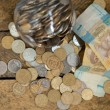 Stock Photo: Ukrainicoins and hryvnas shows poverty