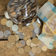 Ukrainicoins and hryvnas shows poverty — Stock Photo #11175009