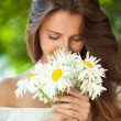 Woman with daisies — Stock Photo #11962302