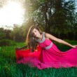 Stock Photo: Womin long pink dress