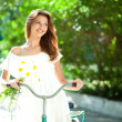 Woman and bicycle — Stock Photo #12224895