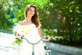 Woman and bicycle — Stock Photo