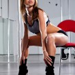 Woman and pole-dance - Stock Photo
