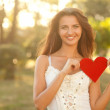 Woman with red heart — Stock Photo #12262229