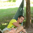 Man in a hammock — Stock Photo