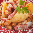 Jacket potato with white beans and bacon — Stock Photo #12048156