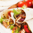 Grilled chicken and salad in tortilla wrap — Stock Photo #12050329