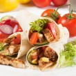 Grilled chicken and salad in tortilla wrap — Stock Photo #12050394