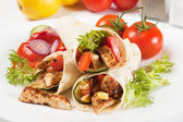 Grilled chicken and salad in tortilla wrap — Stock Photo