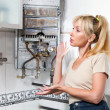 The housewife is afflicted, the gas water heater broke - Stock Photo