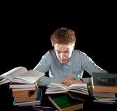 Подросток с кучей учебников — Стоковое фото