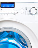The washing machine - a close up of the display, the manhole and a choice of programs — Stock Photo